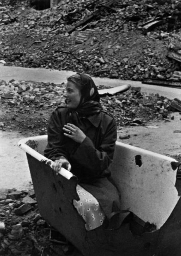 Ingrid Bergman posing for Capa in a bathtub (Berlin, 1945) by Carl Goodwin